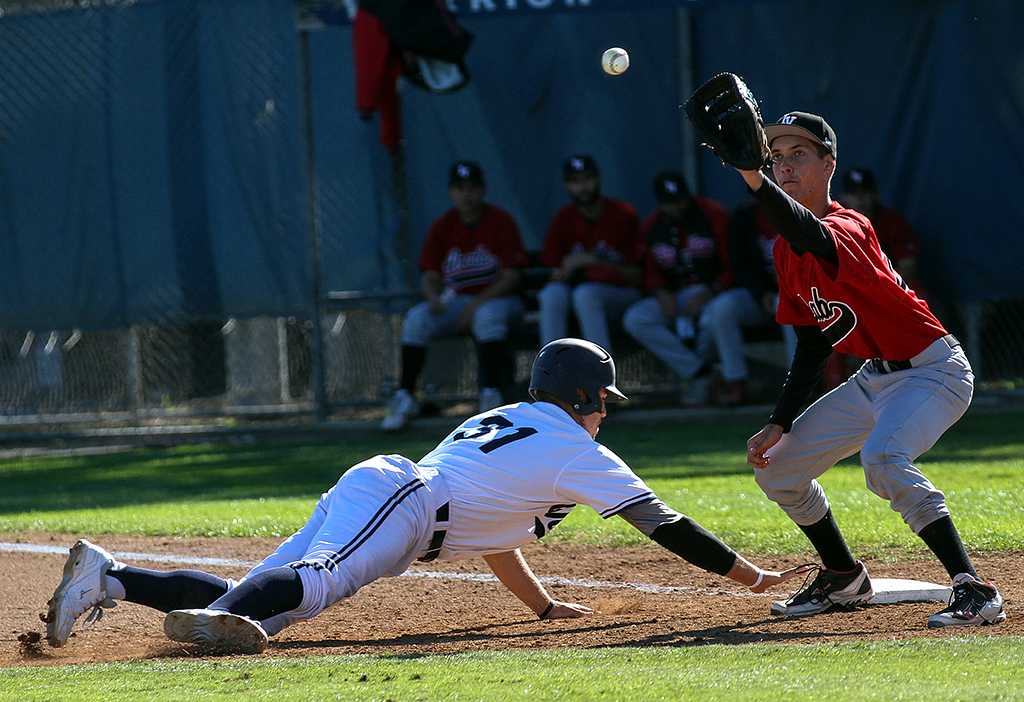 Sean Issac, pitcher and utility player for the Warriors, dives back to first base in the bottom of the third inning of the Warriors Feb. 22 home game against Imperial Valley College.
