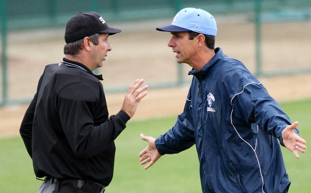 Head Coach Nate Fernley pleads with the home plate umpire during a game at Cerritos College on Saturday.
