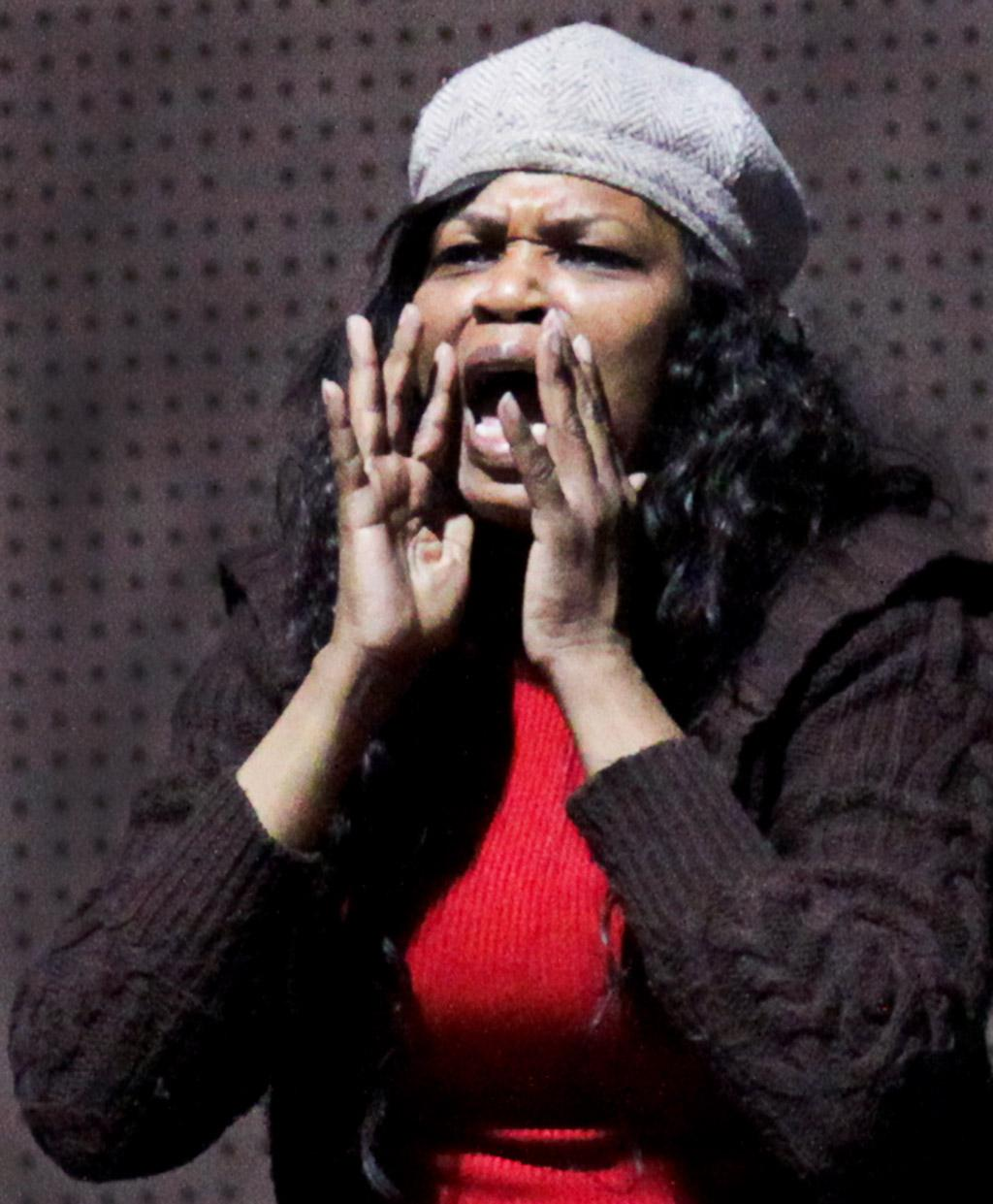 Tracee Wilson, the aunt of Warriors\' point guard Josh Wilson, shouts encouragement to the team during the Warriors Feb. 15 basketball game against the Los Angeles Harbor College Seahawks.