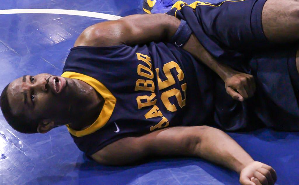 Aubrey Myers, forward for the Los Angeles Harbor Seahawks, takes a moment to recover after a collision with a Warriors\' player during the second half of the Warriors\' Feb. 15 game against the Seahawks.