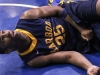 Aubrey Myers, forward for the Los Angeles Harbor Seahawks, takes a moment to recover after a collision with a Warriors' player during the second half of the Warriors' Feb. 15 game against the Seahawks.
