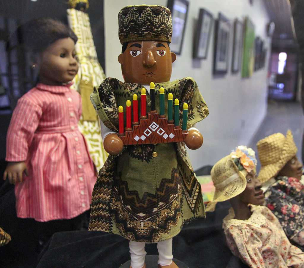 A collection of dolls depicting different types of clothing worn by African Americans during certain time periods and in different cultural settings, sits on display in the Schauerman Library as part of the 2013 Black History Month Exhibit. The exhibit was curated by Maria Brown, history professor, who used her own personal collection of African-American-history memorabilia to create the exhibit, which will be on display until Feb. 29.