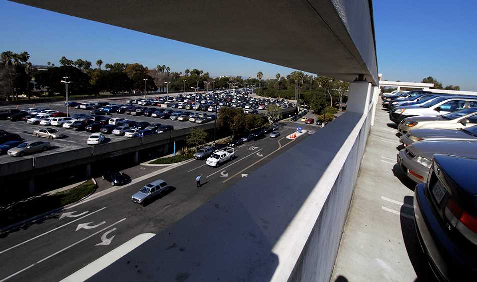 Parked vehicles fill parking lot H and L as cars circle trying to find a spot Tuesday.