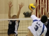 Race Munger and Hunter Hovland go above the net in attempts to block a spike from Santa Monica College on Friday at El Camino College.