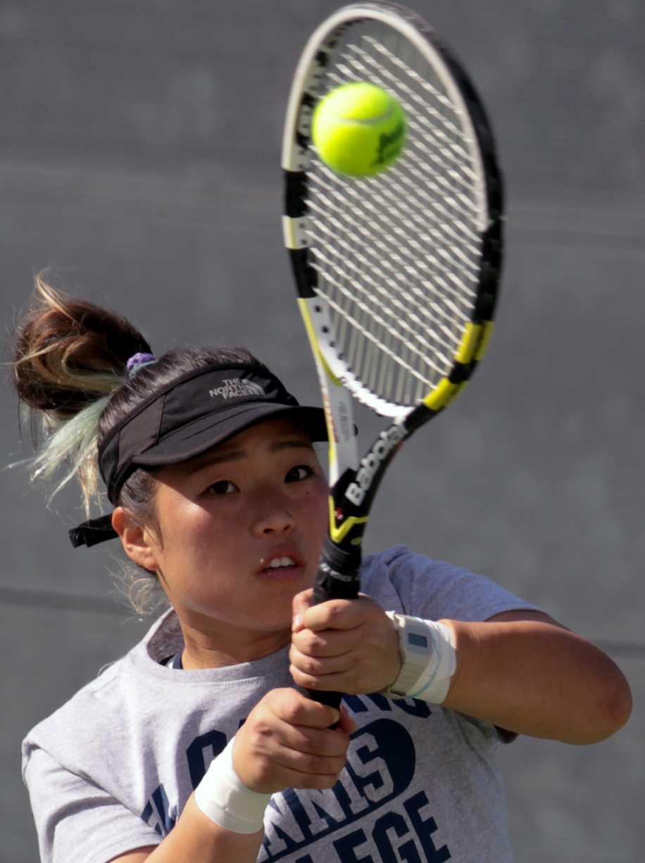 Kia Choi, 20, member of the Warriors women's tennis team, returns the tennis ball in a match against Long Beach City College tennis player Mirinana Hernandez during the Warriors' Feb. 21 tennis tournament against LBCC.  Choi won the Match 6-0, 6-0.
