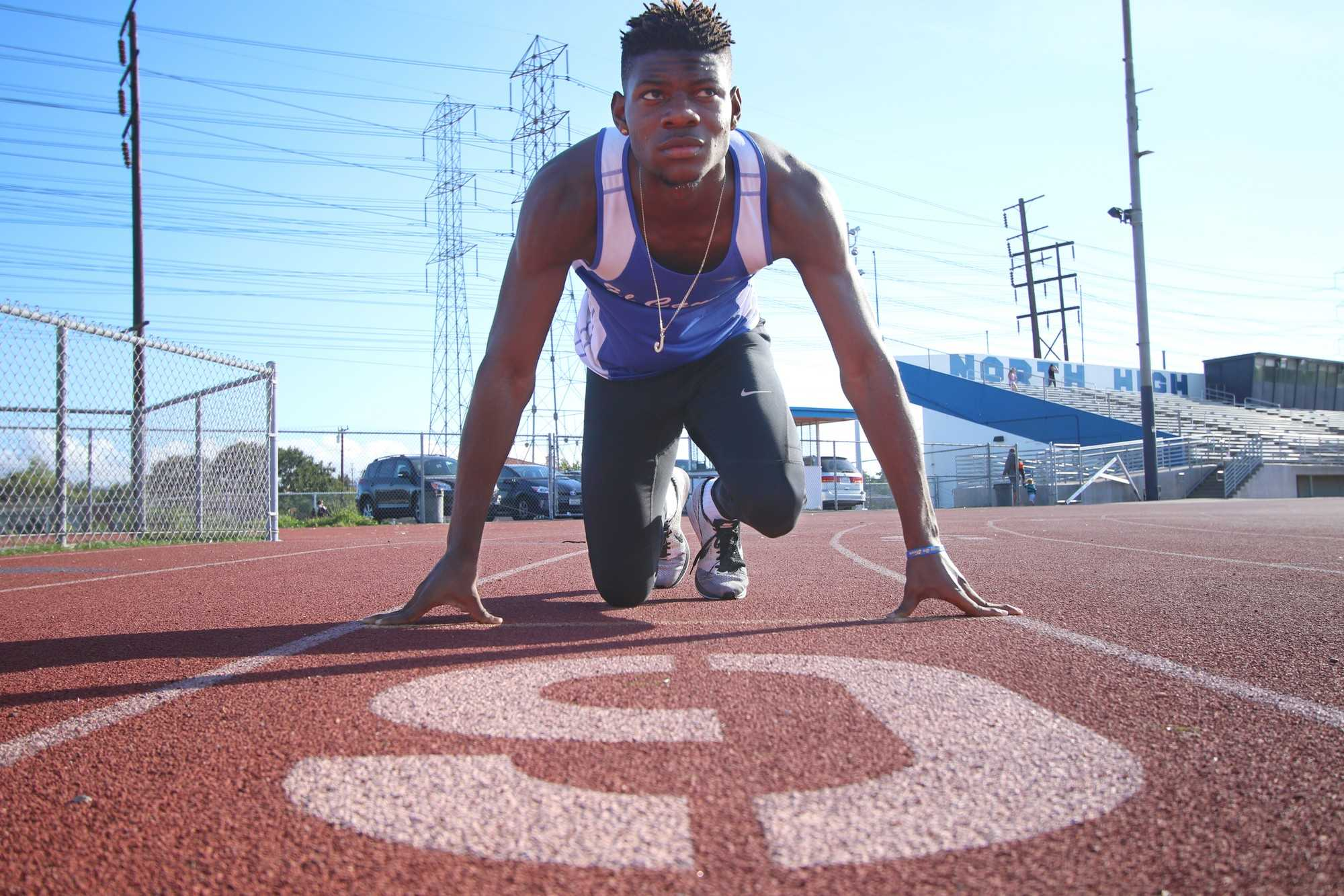 Freshman hurdler Justin Alexander looks up as if he is about to take off at North High School Friday, April 22. Alexander is number one in state for the 400-meter hurdles for junior colleges and is number six in the under 20 in the U.S. Photo credit: Jo Rankin