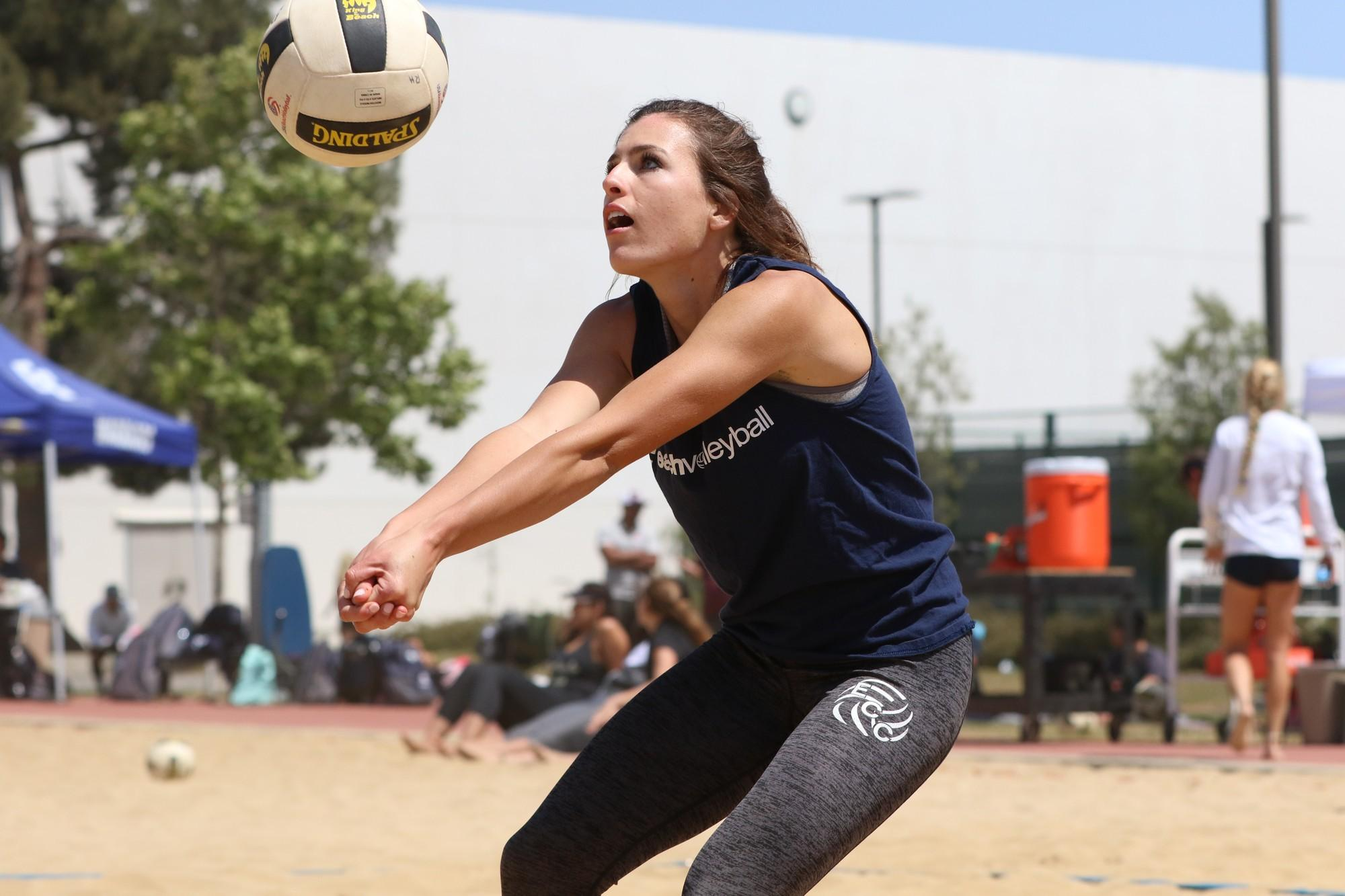 Beach volleyball team individual pairs make it to round two of playoffs