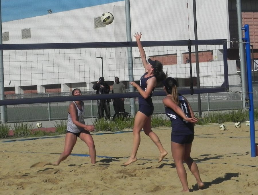 Sophmore+Victoria+Curtice+spikes+the+ball+during+one+of+the+game+against+Cypress+College.+The+game+took+place+at+the+sand+volleyball+courts+on+campus+on+Wednesday+Feb.+15.