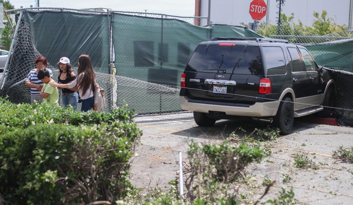 Two vehicles collide next to Parking Lot B; car crashes into construction fence