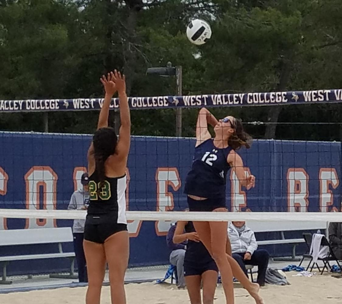 Freshman+El+Camino+beach+volleyball+player+Micah+Hammond+attacks+the+ball+against+Feather+River+College%27s+Cyan+Blackdeer+in+the+Round+of+16+in+the+State+Individual+Tournament+on+Saturday%2C+May+6.%0A%0AHammond+and+partner+sophomore+Michelle+Shimamoto+advanced+all+the+way+to+the+State+Finals+match+on+Sunday%2C+May+7+and+eventually+lost+to+claim+second+place.+Photo+credit%3A+Phil+Sidavong