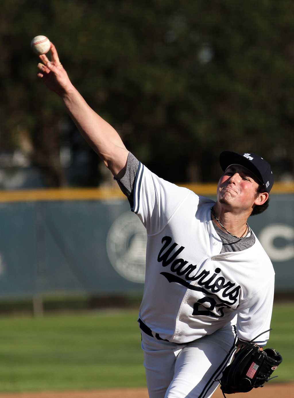 Kevin McMahon, pitcher for the Warriors, delivers a pitch in the top of the sixth inning of the Warriors Feb. 22 home game against Imperial Valley College.
