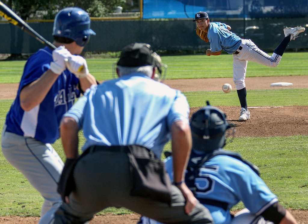 Alex Navarrete, pitcher for the Warriors baseball team, delivers a strike to Brett Torrence, outfielder for San Bernardino Valley College, in the first inning of the Warriors Feb. 16 game. The Warriors won the game, 12-3.