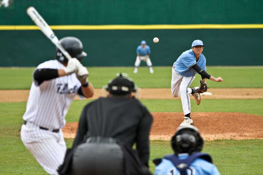 Starting Pitcher Alex Mistuloff, hurls a pitch against the Falcons on Saturday.  The warriors lost the game 2-8.