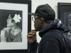 Clarence Bruton, 32, English literature major, studies a drawing of  African American singer Bessie Smith during the Feb. 15 reception for the 2013 Black History Month Exhibit, which will be on display in the lobby of the Schauerman Library until Feb. 29. Maria Brown, history professor, curated the exhibit and all the items in it are from her personal collection of African American history-related pictures and memorabilia.