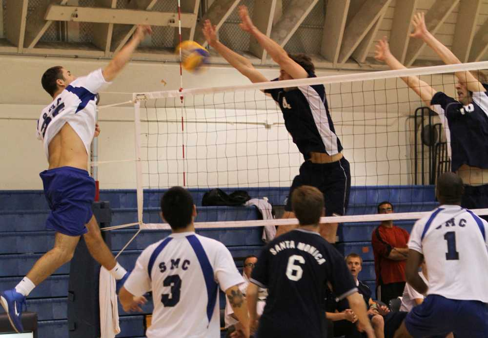 El Camino's Nick Demarco and Race Munger attempt to block a spike against Santa Monica at El Camino College on friday.