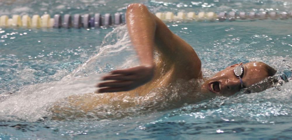 Freestyle swimmer Brandon Gregory gasps for air during his race at El Camino College against visiting Harbor and Cerritos on Friday.