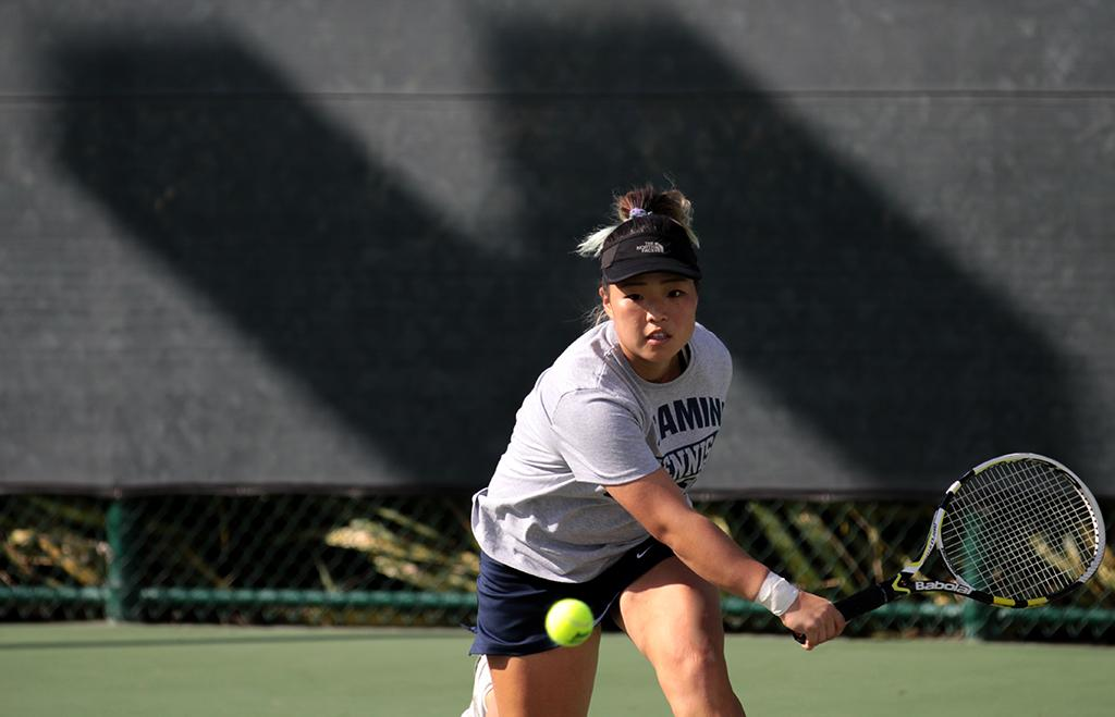 Kia Choi, 20, member of the Warriors women's tennis team, chases down the tennis ball in match against Long Beach City College tennis player Mirinana Hernandez during the Warriors' Feb. 21 tennis tournament against LBCC.  Choi won the Match 6-0, 6-0.