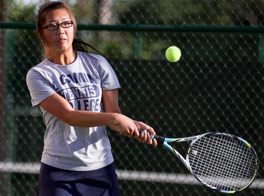 Karin Endo, 21, member of the Warriors women's tennis team, returns a serve during a Feb. 21 doubles match against Long Beach City College players. The match was part of a women's tennis tournament with LBCC that was hosted at EC. The Warriors Women's tennis team won the tournament, taking all nine matches.
