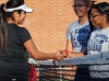 Warriors women's tennis team players Heather Shambrey, 18, and Karin Endo, 21, shake hands with Long Beach City College player Mirinana Hernandez at the start of a doubles match that was part of the Feb. 21 tennis tournament held at EC. The Warriors women's tennis team won the tournament, taking all nine matches against LBCC