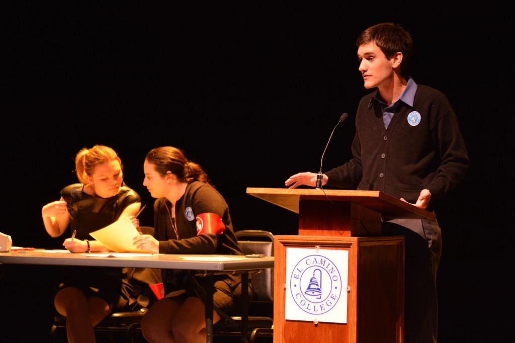 Nicholas Bishop, international relations, argues against against the faculty union's salary proposal in the Campus Theater on March 31. The EC debate team held the debate to frame the ongoing negotiations between the school board and the faculty union. Photo credit: John Fordiani