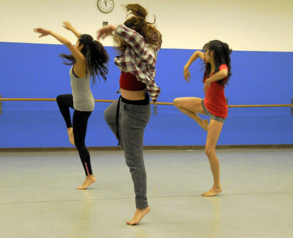 From left, Alisa Carreras, 20, dance major, Christina Morales, 23, dance major and Catherine Chavez,dance major goes over their dance routine in the P.E. dance room. They will dance in the upcoming Spring Dance Concert. Photo credit: Amira Petrus