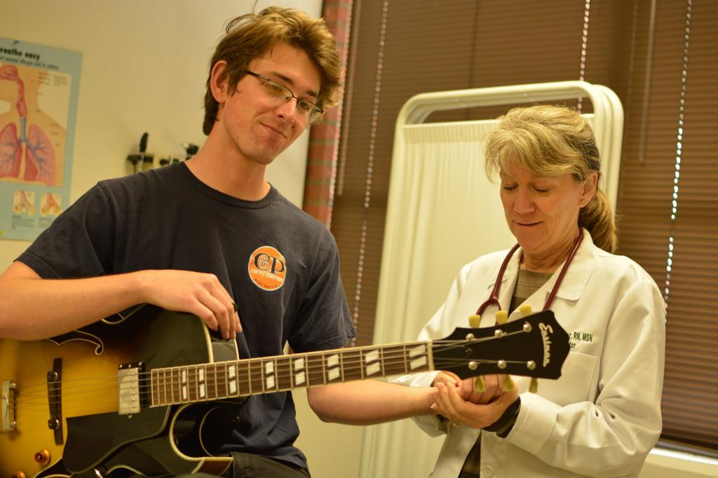 Jared Sachs, 20, music major, has his wrist checked by student health services coordinator Debbie Conover. Sachs regualry recieves treatment for his carpal tunnel syndrome. Photo credit: John Fordiani