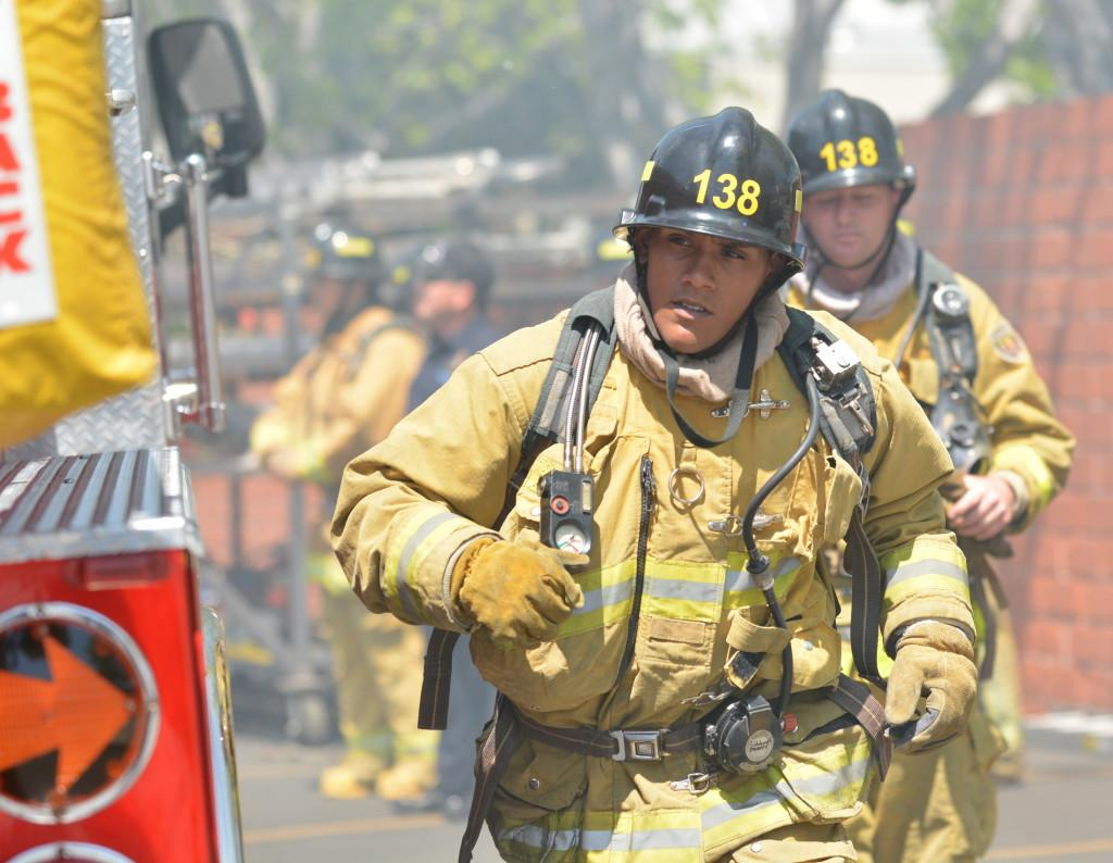 Leonardo Perez, EC Fire Academy recruit, runs to connect a fire hose to a hydrant at the ECFA graduation on April 11 in Inglewood Calif. Class 138 recently finished an intensive, 10-week long academy. Photo credit: John Fordiani