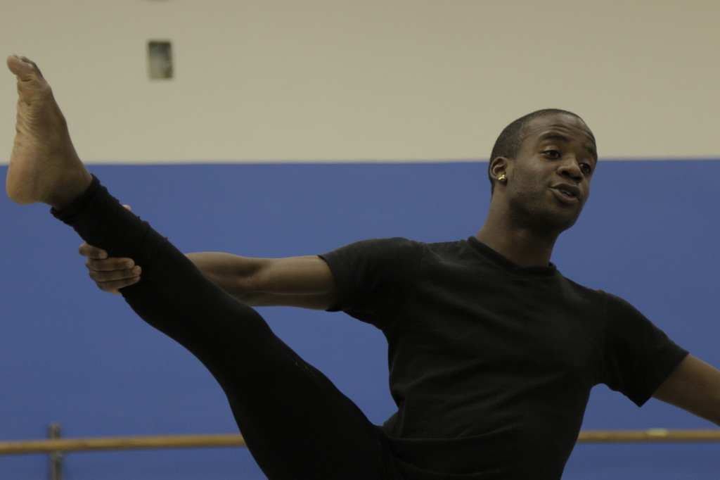 Jamie Burton, 20, dance major hinging back in a full stretch during rehearsals. Photo credit: Cary Majano