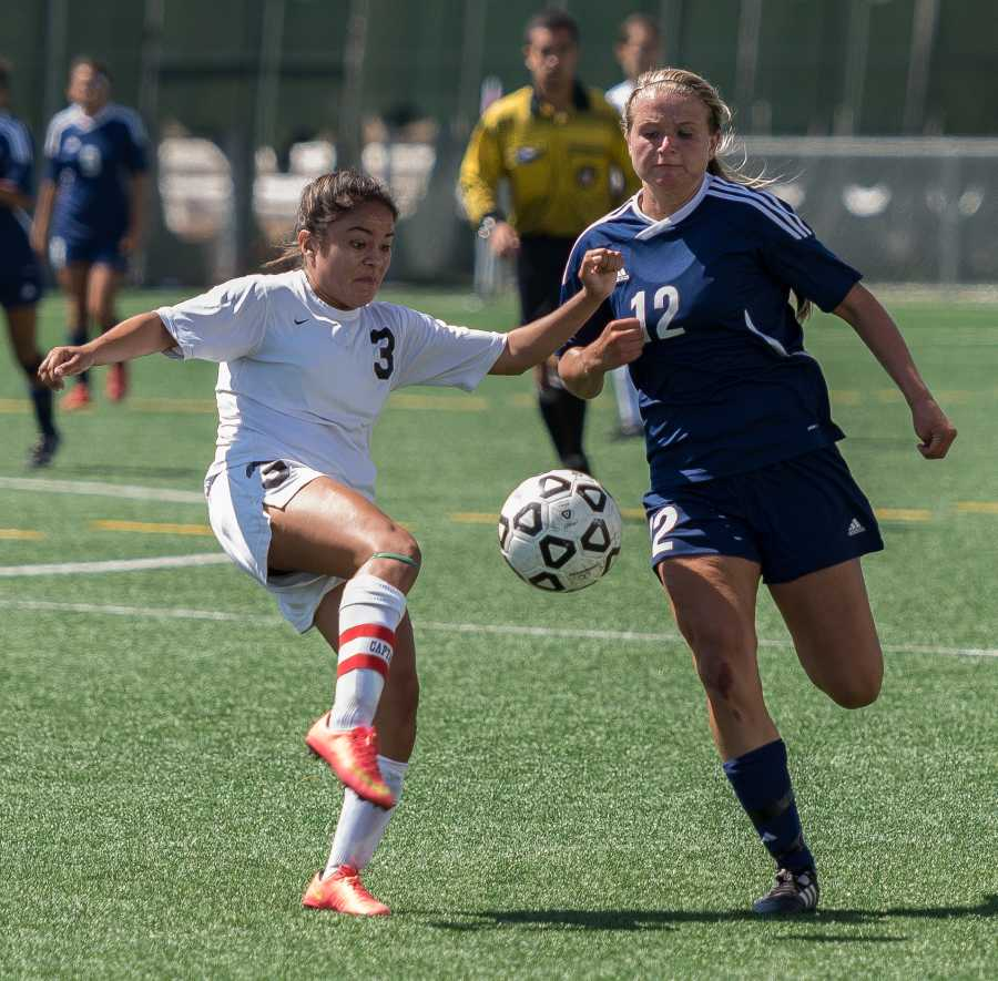 Freshman forward Kaley German battles against the Lady Eagles' Valeria Garcia for control of the ball during EC's 2-0 loss against Mt. San Jacinto College last Saturday. The defeat puts the Warriors' overall record at 1-2 for the season so far.