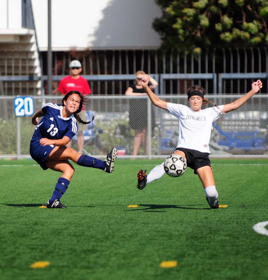 Freshman forward Tatiana Granados attempts to cross the ball across the field to a teammate. Photo credit: Amira Petrus