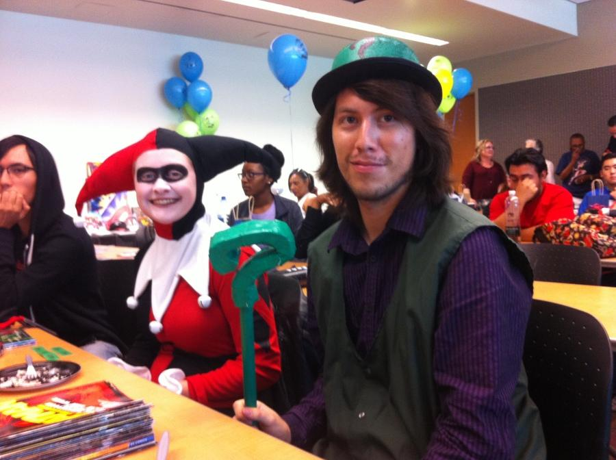 Two of Batman's worst enemies sit side by side during Comic Book Day. Krista Williams, 20, film major, and Fernando Meza, 25, CIS major, attended the events in the Distance Education Center Tuesday. Photo credit: Armando Zelaya