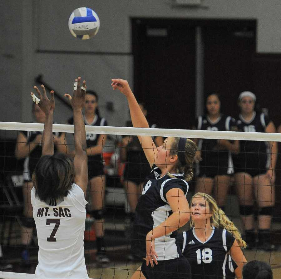 Middle blocker Kimberly Haney goes for a kill against Mt. SAC. Photo credit: Tristan Bellisimo