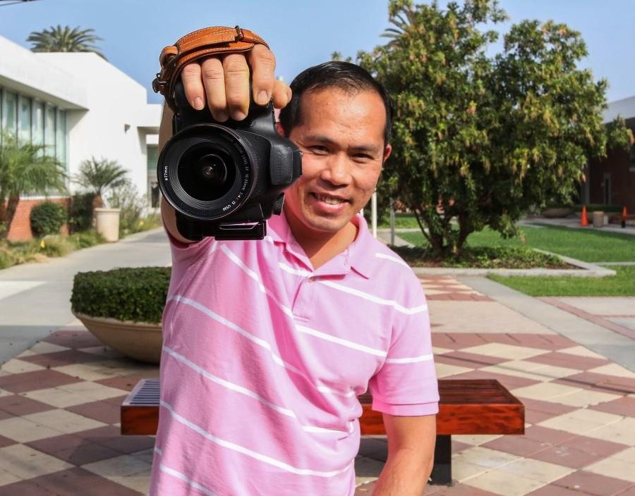 Tony Pham, 39, photography and nursing major, shows off his Canon 5d mark iii camera. Pham enjoys shooting landscapes and he desires to volunteer nursing overseas to help African refugees while taking pictures of the sceneries. Photo credit: Jorge Villa