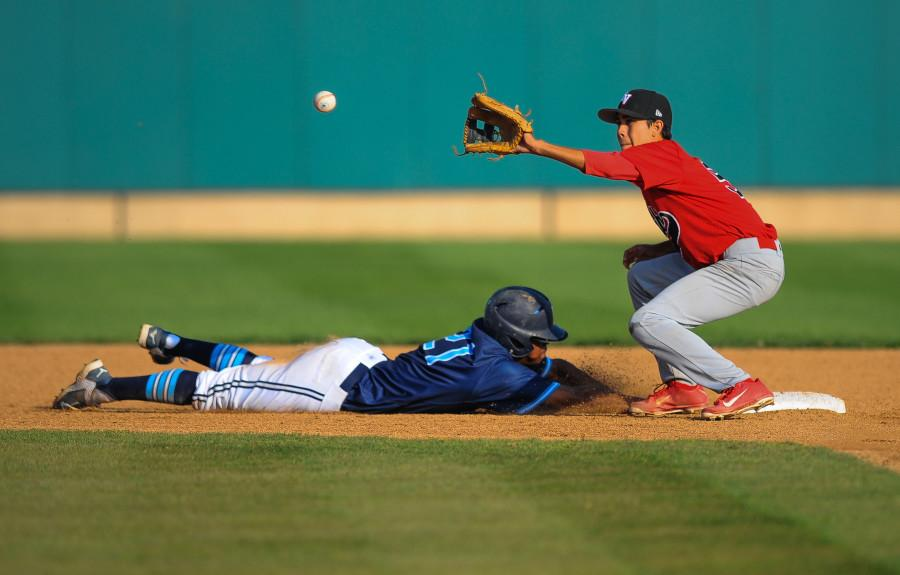 Warriors outfielder Alex Turner slides into second base before a Imperial Valley second baseman catches the ball. The Warriors defeated the Arabs 5-3 on Thursday. Photo credit: Tristan Bellisimo