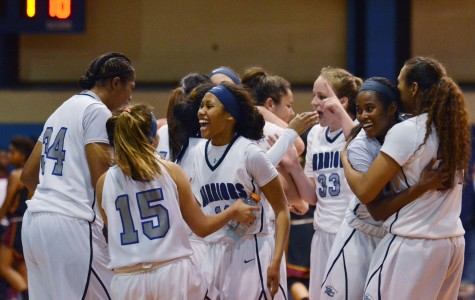 The women's basketball team celebrates after defeating Pasadena City College in the second round of playoffs. The Warriors defeated the Lancers 71-64 in overtime on Friday night. Photo credit: John Fordiani