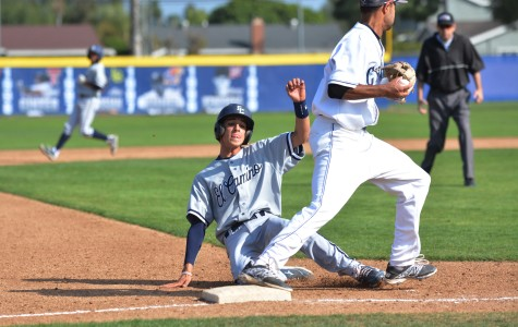 Warriors infielder Tyler Martizia slides into third base just as a Cypress College third baseman catches the ball. The Warriors lost to the Chargers 6-5 on Saturday. Photo credit: John Fordiani