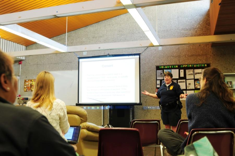 EC Police Officer Jan Caldwell presents a powerpoint about Bystander Awareness in the Social Justice Center on Friday Feb. 26. Caldwell presented tips on sexual assault prevention and how college students can protect themselves. Photo credit: Armando Zelaya