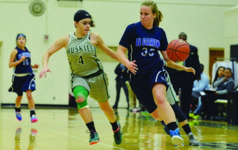 Freshman forward Jill Thebodeau (right) fights for possession of the ball against East Los Angeles College. The Warriors were eliminated from the playoff after losing to the Huskies 70-56 on Wednesday night. Photo credit: John Fordiani