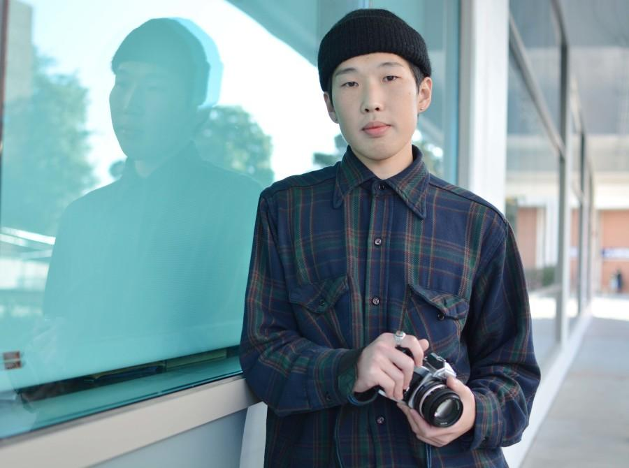 Narihiko Kumagae, 26 an international student from Japan has been in the United States for only a year and is already leaving his mark. Kumagae shoots black and white street photography with his Nikon film camera. Photo credit: John Fordiani