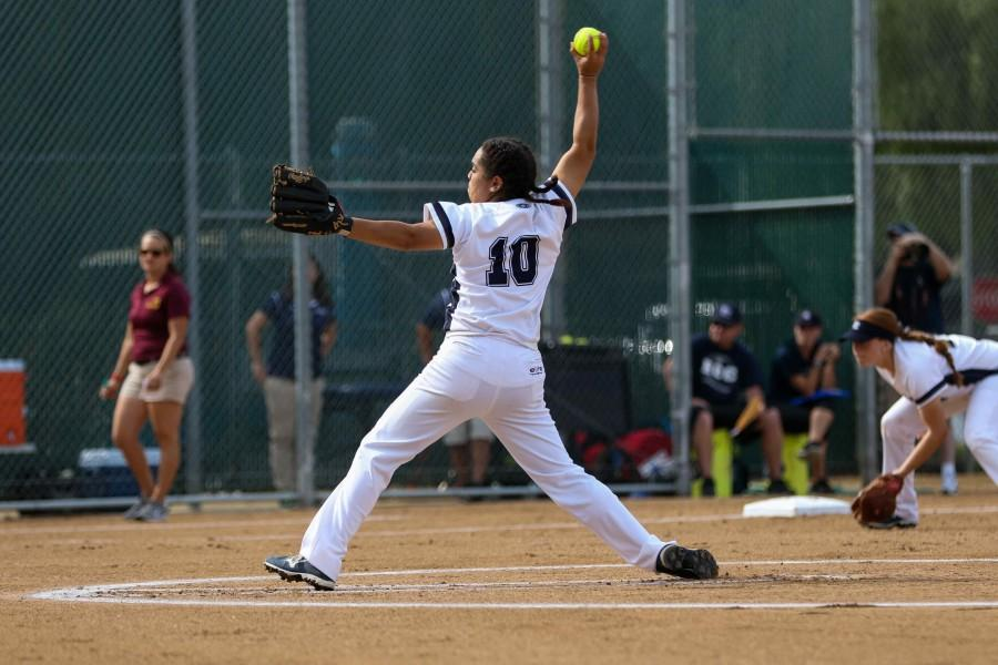 Warriors sophomore Reina Trejo starting strong in the first inning of pitching against the Lancers. The Warriors take the win 12-8 against Pasadena City College on Tuesday.