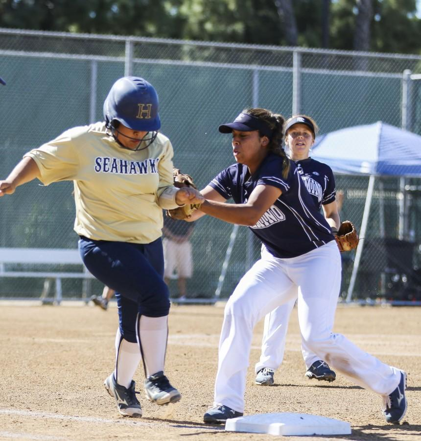Warriors first base Jacqueline Gonzalez takes out a player from LA Harbor college on first base at Thursday's home game. The Warriors defeated the Seahawks 4-0, giving the softball team a seven-game win streak. Photo credit: Jorge Villa