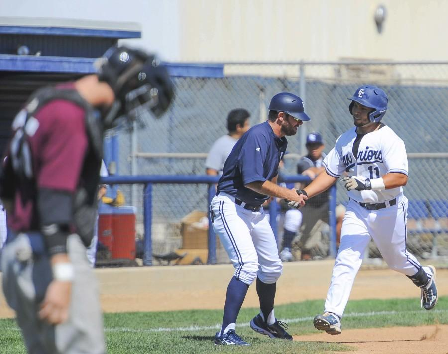 Warriors+outfielder+Jonathan+Pasillas+runs+to+home+plate+on+March+30.+The+Warriors+defeated+Antelope+Valley+College+14-3+Monday+afternoon.+Photo+credit%3A+Tristan+Bellisimo