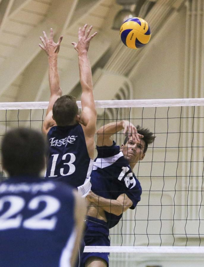 Warriors outside hitter Casey Woods successfully spikes the ball against Irvine Valley's Cody Hermanson on Friday night. The Warriors defated the Lasers 3-0 in the first round of the Southern California Regional playoffs. The Warriors advance to the next round as they play against Grossmont College  in San Diego on April 23. Photo credit: Jorge Villa