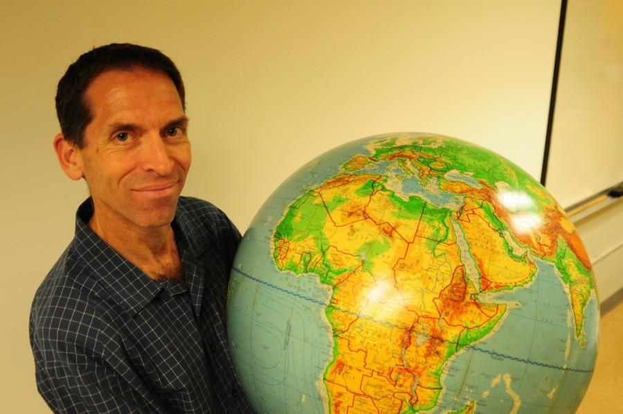 Matt Ebiner, a geography professor at El Camino, holds one of the many globes in his classroom. He is also the founder of GeoTours, a travel company made to take both students and non-students on trips abroad during school breaks, according to his website. Ebiner teaches World Regional Geography courses every semester. Photo credit: Armando Zelaya