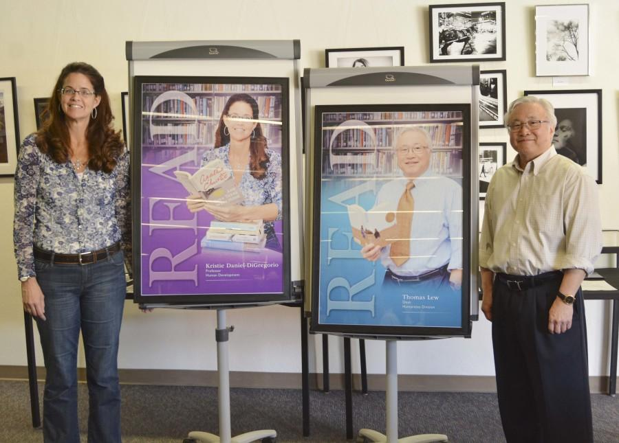 Kristie Daniel Di-Gregorio, human development professor, and Dean of Humanities Tom Lew stand next to their new unveiled READ posters in the library on Thursday, April 16. Photo credit: John Fordiani