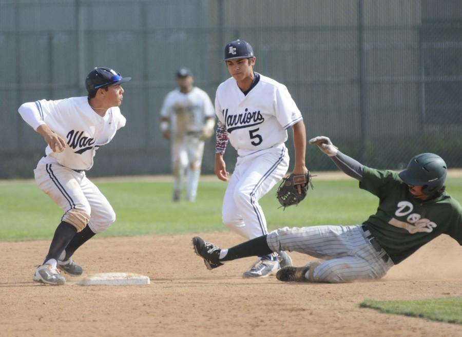 Warriors infielder Fred Smith gets an East Los Angeles player out at second base in the bottom of the fourth inning. El Camino defeated the Huskies 10-4 on Tuesday afternoon. Photo credit: John Fordiani