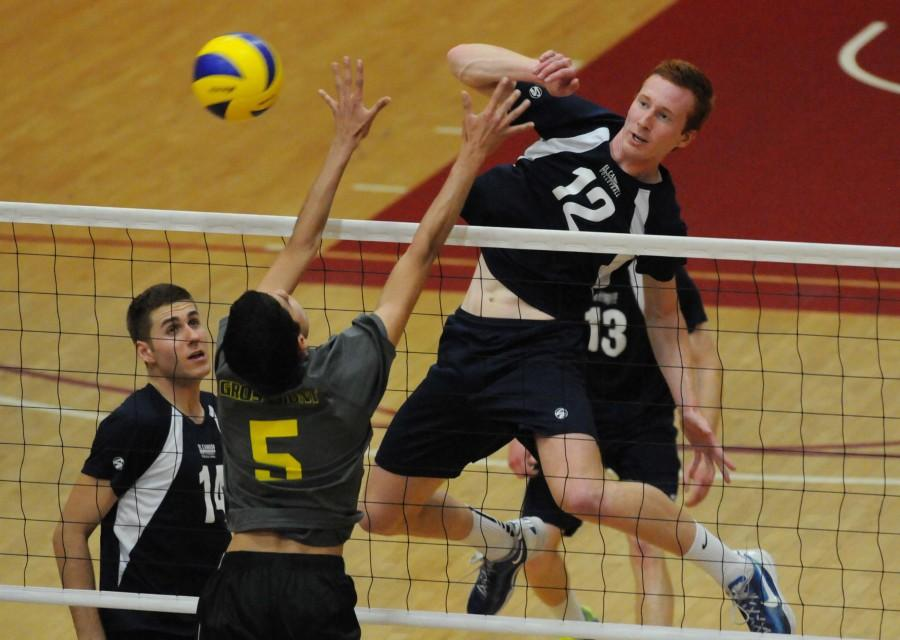 Warriors middle blocker Peter Nordel spikes the ball past Grossmont College middle blocker Andres Verjan during the third set of the state semi finals on Thursday evening. The Warriors defeated the Griffins 3-2 at San Diego City College. The Warriors will play Santa Monica College on Saturday for the state championship. Photo credit: John Fordiani