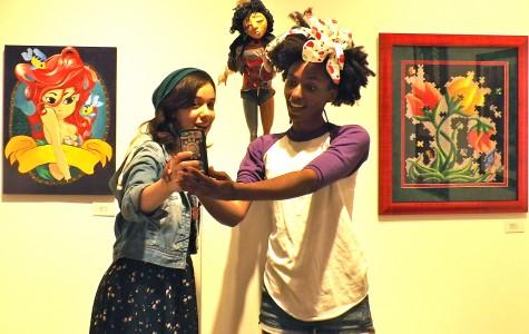 Mercedes Hunter, 25, art illustration major (right), takes selfie of her art work with Melissa Mc Donalds, 22, art illustration major. Photo credit: Shontel Leake