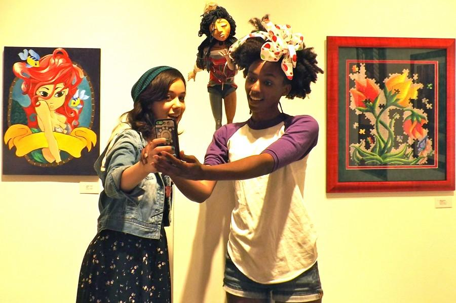 Mercedes Hunter, 25, art illustration major (right), takes selfie of her art work with Melissa Mc Donalds, 22, art illustration major. Photo credit: Shontel Leake