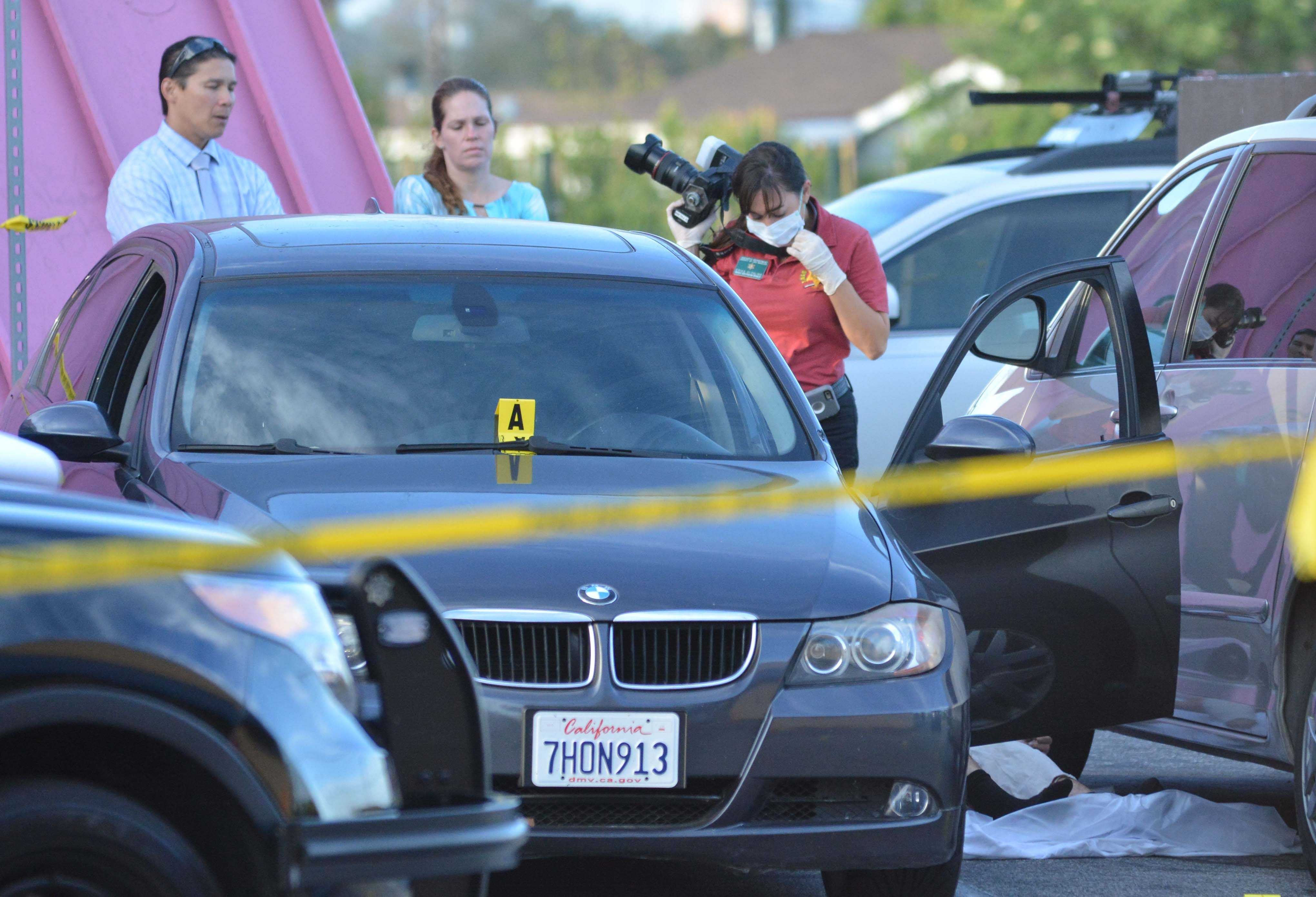 Los Angeles County Sheriff investigators document the scene in the 3400 block of Crenshaw Boulevard, where an El Camino student was shot to death. Photo credit: John Fordiani